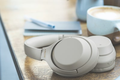 Sony noise-cancelling headphones with BLUETOOTH on desk