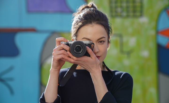 Portrait of woman taking photos outdoor